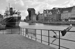 Old Harbor in Gdansk. Old harbour on Motlawa river in Gdansk, Poland. Old steamer Soldek on the left, young man training on the right Royalty Free Stock Photography
