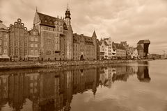 Old Harbor of Gdansk With Medieval Mast Crane. Old harbour on the Motlawa river in Gdansk in Northern Poland. Renaissance houses and medieval mast crane on the Royalty Free Stock Photography