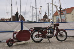 Classic motorbike in the Old Harbor in Gdansk. Old harbour on Motlawa river in Gdansk, Poland. Old classic Polish motorcycle WFM in the foreground Stock Photo