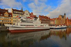 Old Harbor of Gdansk With Ships Mooring. Old harbour on the Motlawa river in Gdansk in Northern Poland. Renaissance houses in the background and cruise ships Royalty Free Stock Photography