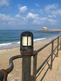 Old harbor and lamp in Caesarea Stock Photography