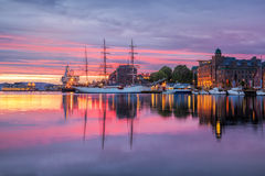 Old harbor with sail boat against sunset in Bergen. UNESCO World Heritage Site, Norway Royalty Free Stock Photo