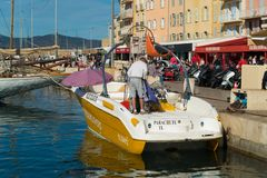 Old harbor of st tropez. ST TROPEZ, FRANCE - OCTOBER 24, 2017: Quay of the famous old harbor of St Tropez on a sunny autumn day royalty free stock images