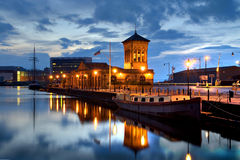 Old harbour building leith, edinburght. With ship in the front Stock Photos