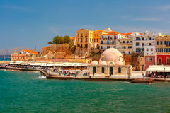 Old harbour, Chania, Crete, Greece. Old harbour of Chania with Venetian quay and Kucuk Hasan Pasha Mosque in the sunny morning, Crete, Greece Stock Image