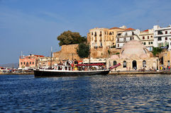 The old harbour in Hania. The town of Hania in Crete Greece with the old harbour and Janissaries' Mosque, built in 1645 it is the oldest surviving Ottoman Royalty Free Stock Photography