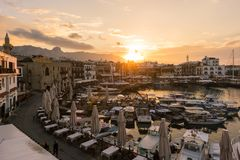 Old harbour of Kyrenia during beautiful sunset. KYRENIA, CYPRUS - FEBRUARY 22, 2018: Old harbour of Kyrenia during beautiful sunset. Kyrenia Girne harbour is royalty free stock image