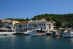 The old harbour, Limenas, Thassos, Greece. The old harbour of Limenas, the capital of the island of Thassos, with the famous Kalogeriko, the friar's house - the Stock Photography