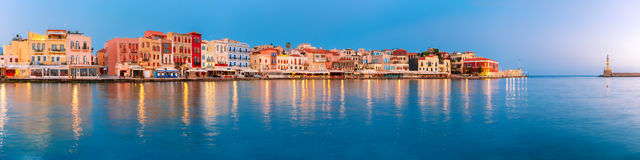 Old harbour at sunrise, Chania, Crete, Greece. Picturesque panoramic view of old harbour with Lighthouse of Chania at sunrise, Crete, Greece Royalty Free Stock Photos