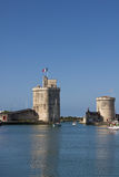 Old harbour towers - La Rochelle. Old harbour of La Rochelle in France with the Tour Saint-Nicolas  and Tour de la Chaine, defending in the past, this charming Stock Photography