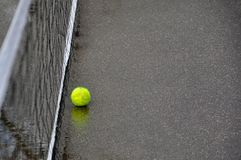 old tennis ball in court stock photos