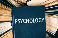 Old hardback books with book Psychology on top. Stock Photos