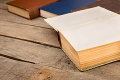 Old hardback books or text books on wooden table. Old and used hardback books or text books on wooden table royalty free stock photography