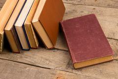 Old hardback books or text books on wooden table. Old and used hardback books or text books on wooden table stock image