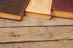Old hardback books or text books on wooden table. Old and used hardback books or text books on wooden table royalty free stock photos