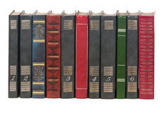 Old hardcover books in a row stock images