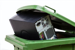 Old hardware. Damaged computer in a green container, isolated Royalty Free Stock Image