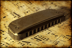Old harmonica Stock Images
