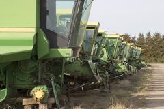 Old harvester boneyard. A row of old harvester in the salvage yard royalty free stock photos