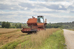 Old harvester on the field Royalty Free Stock Photo