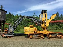 Old harvester in yard with old forestry equipment stock photo