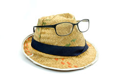 Old hat made of woven with eyeglasses Stock Photo