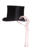 Old hat with skeleton hand. On white background royalty free stock photos
