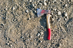 Old hatchet on the ground Royalty Free Stock Images