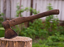 Old Hatchet in Wood Royalty Free Stock Photos