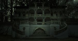 Old haunted house in a dark horror atmosphere stock photos