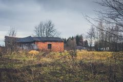 Old haunted house on the empty field Stock Image