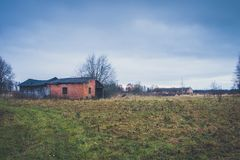 Old haunted house on the empty field.  Royalty Free Stock Photography