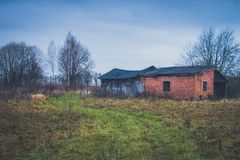 Old haunted house on the empty field.  Royalty Free Stock Photo
