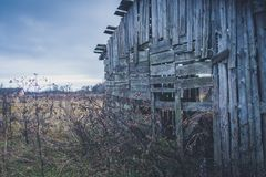 Old haunted house on the empty field.  Royalty Free Stock Images
