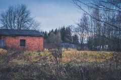 Old haunted house on the empty field.  Stock Photography