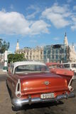 Old havana. Ancient architecture of the Capitol in Havana cuba site with its distinctive cars 60 seat from time tourism Royalty Free Stock Photography