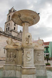 Old Havana, Cuba: Fountain with lions and San Francisco church stock image
