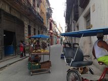 Old Havana - Cuba - Street, bicitaxi & fruit stall Stock Photo