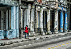 Old Havana Cuba street. Cuban working women walking down an old Havana street filled with decaying cement pillars and bad electrical Royalty Free Stock Image