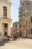 Old Havana. Horse with red brougham stands on sunny street of old Havana stock photo