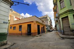Old Havana street with colorful buildings. Under blue sky Stock Photo
