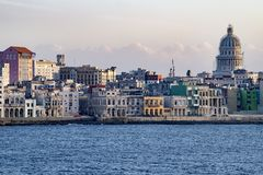 Malecon Havana with colonial buildings and Capitolio, Cuba, seen from seaside. Old Havana - Havana Vieja - with colorful colonial buildings and Capitol in Royalty Free Stock Photos