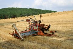 Old hay rake reaper-binder - rustic, oldfashioned farm equipment, used for field works during harvest season. royalty free stock images