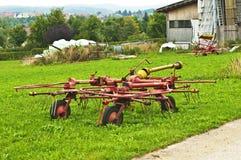 Old hay turning machine Stock Photo