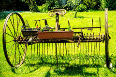 Old hay turning machine Royalty Free Stock Photo