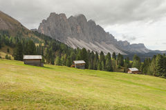 Old hayloft in a pasture in Val di Funes at fall  Dolomites Stock Photo