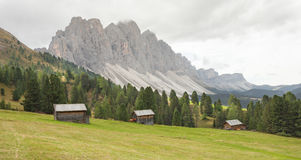 Old hayloft in a pasture in Val di Funes at fall Stock Image