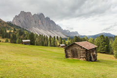 Old hayloft in a pasture in Val di Funes at fall Royalty Free Stock Photos