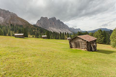 Old hayloft in a pasture in Val di Funes at fall  Dolomites Stock Images