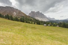 Old hayloft in a pasture in Val di Funes at fall Royalty Free Stock Image
